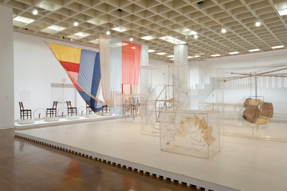 "The ""Main Stage"" of the exhibit. On the left: the set for ""Tantric Geography,"" by Rauschenberg (1977). IN the center, Johns' set for ""Walkaround Time,"" inspired by Duchamp's ""The Glass."" Photo by Constance Mensh."