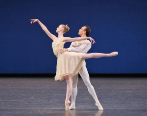 Teresa Reichlen and Tyler Angle in Balanchine's Tchaikovsky Piano Concerto No. 2. Photo by Paul Kolnik.